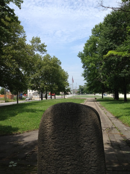 From behind the marker, looking back at the street.