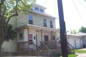 The house I lived in in Erie--the very first day I saw it.  The For Rent sign is still in the door.  I had the top floor.